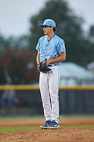 Burlington Royals relief pitcher Zack Phillips (34) looks to his catcher for the sign against the Danville Braves at Burlington Athletic Stadium on August 9, 2019 in Burlington, North Carolina. The Royals defeated the Braves 6-0. (Brian Westerholt/Four Seam Images)