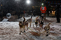 Joar Leifseth Ulsom runs up the finish chute to place second during  the 2019 Iditarod Trail Sled Dog Race. <br /> <br /> Photo by Jeff Schultz/  (C) 2019  ALL RIGHTS RESERVED