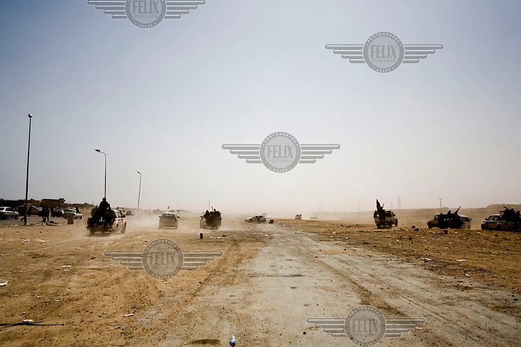 Rebels flee the small coastal town of Ben Jawad as Gaddafi troops launch a huge offensive to push the rebels back after they attempted to advance on the loyalist stronghold of Sirt earlier that day. On 17 February 2011 Libya saw the beginnings of a revolution against the 41 year regime of Col Muammar Gaddafi..