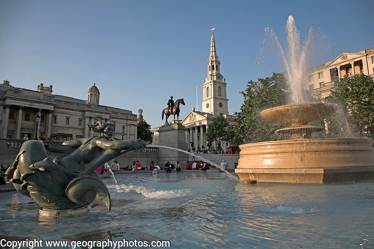 Fountain in Trafalgar Square and Saint Martin´s in the Field church in background, London, England