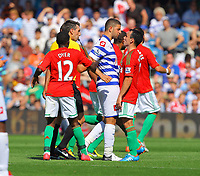FAO SPORTS PICTURE DESK<br /> Pictured: Adel Taarabt (3rd L) square up with Leon Britton of Swansea (R). Saturday 18 August 2012<br /> Re: Barclay's Premier League, Queens Park Rangers v Swansea City FC at Loftus Road Stadium, London, UK.