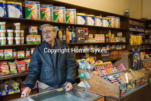 Old fashioned corner shop 79 year old David Brown the proprietor since 1953 when he took over after leaving the army. Brentwood Middlesex London
