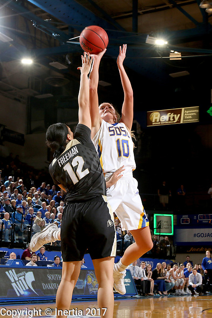 BROOKINGS, SD - MARCH 19:  Kerri Young #10 from South Dakota State shoots over the defense of Ariana Freeman #12 from Colorado during their second round WNIT game at Frost Arena March 19, 2017 in Brookings, South Dakota. (Photo by Dave Eggen/Inertia)