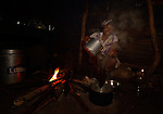 Cebonet Alcide makes coffee in the predawn darkness in Despagne, an isolated village in southern Haiti where the Lutheran World Federation has been working with residents to improve their quality of life.