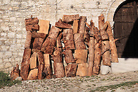 Pile of logs for firewood outside a house in Berat Castle or Kalaja e Beratit, in Berat, South-Central Albania, capital of the District of Berat and the County of Berat. The castle dates mainly from the 13th century and contains Byzantine churches, Ottoman mosques and housing. It is built on a rocky hill on the left bank of the river Osum. Picture by Manuel Cohen