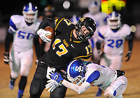 NWA Democrat-Gazette/ANDY SHUPE<br /> Dylan Soehner (17) of Prairie Grove carries the ball as he is hit by Blake Wynn (right) of Star City Friday, Nov. 27, 2015, during the first half of play at Tiger Stadium in Prairie Grove. Visit nwadg.com/photos to see more photographs from the game.