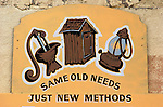 """Same old needs, just new methods"" sign on Pioche Public Utilities office"