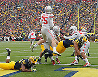 Michigan Wolverines safety Jordan Glasgow (23) runs into Ohio State Buckeyes punter Cameron Johnston (95) for a roughing the kicker penalty in the 1st quarter at Michigan Stadium in Arbor, Michigan on November 28, 2015.  (Dispatch photo by Kyle Robertson)