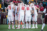 Wisconsin Badgers offense huddles during an NCAA College Big Ten Conference football game against the Minnesota Golden Gophers Saturday, November 25, 2017, in Minneapolis, Minnesota. (Photo by David Stluka)