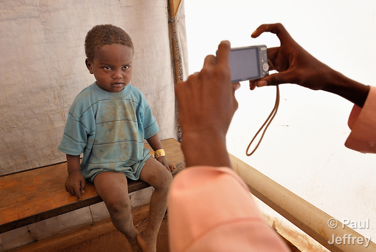 A newly arrived Somali refugee gets his picture taken, part of the registration process for new refugees in the Dadaab refugee camp in northeastern Kenya. Tens of thousands of newly arrived Somalis who have swelled the population of what was already the world's largest refugee camp.