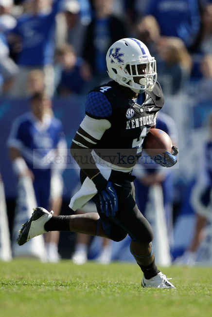 Kentucky Wildcats running back Raymond Sanders (4) during the second half of the University of Kentucky vs. Mississippi State football game at Commonwealth Stadium in Lexington, Ky., on Saturday, October 6, 2012. Photo by Tessa Lighty | Staff