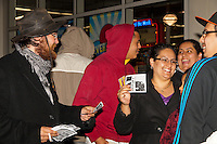 Justin H., an Occupy Orange County, Irvine protestor, hands out fliers to customers lined up at the Old Navy at South Coast Plaza early in the morning (12:48am) on Black Friday.