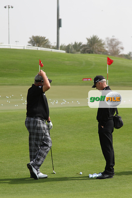 Darren Clarke and Pete Cowan during the Abu Dhabi HSBC Golf Championship 2013.Picture: Fran Caffrey / www.golffile.ie ..
