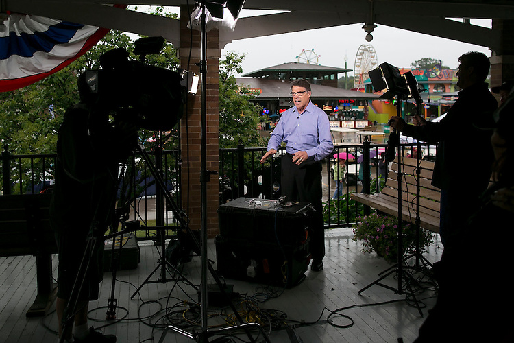 UNITED STATES - August 17: Republican presidential candidate Rick Perry speaks adamantly about his experience in securing the nations borders during a television interview at the Iowa State Fair on Tuesday, August 18, 2015 in Des Moines, Iowa. (Photo By Al Drago/CQ Roll Call)