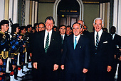 United States President Bill Clinton, left, walks through the US Capitol in Washington, DC with the Taoiseach of Ireland Albert Reynolds, center, and Speaker of the US House of Representatives Tom Foley (Democrat of Washington), right, as they attend the Friends of Ireland St. Patrick's Day luncheon on Wednesday, March 17, 1993.<br /> Credit: Jim Colburn / Pool via CNP