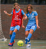 20190915– HALLE , BELGIUM : FP Halle-Gooik Girls B player Stacey Comblez (in red) and FP Halle Gooik A player Melissa Tom are pictured during the Belgian Women's Futsal D1 match between FP Halle-Gooik A and FP Halle-Gooik B on Sunday 15th 2019 at the De Bres Sport Complex in Halle, Belgium. PHOTO SPORTPIX.BE | Sevil Oktem