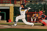 Burlington Bees Michael Hermosillo (4) swings during the Midwest League game against the Peoria Chiefs at Community Field on June 9, 2016 in Burlington, Iowa.  Peoria won 6-4.  (Dennis Hubbard/Four Seam Images)
