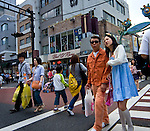 "Older man and younger woman crossing a street in Harajuku, Tokyo, Japan. Harajuku is reknowned for its outrageous youth fashions and ""bo beep"" girls. Editorial Only.."