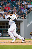 Avisail Garcia (43) of the Charlotte Knights follows through on his swing against the Gwinnett Braves at BB&T Ballpark on August 6, 2014 in Charlotte, North Carolina.  The Knights defeated the Braves  12-10.  (Brian Westerholt/Four Seam Images)