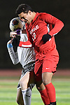 Kirkwood defender Mark Corley (front) wins the header from CBC forward Dillon Byrkit. CBC played Kirkwood in a Class 4 sectional soccer game at Kirkwood High School in Kirkwood on Thursday November 14, 2019.<br /> Tim Vizer/Special to STLhighschoolsports.com