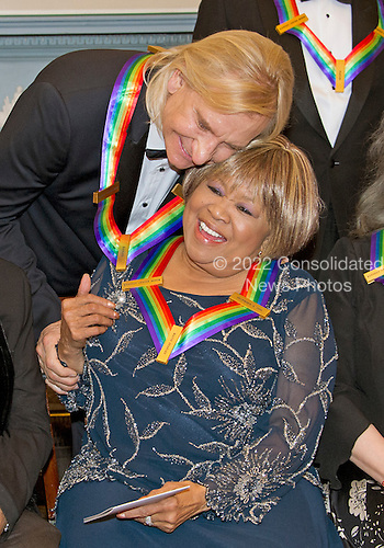 "Joe Walsh of the rock band ""The Eagles,"" left, one of the five recipients of the 39th Annual Kennedy Center Honors, hugs gospel and blues singer Mavis Staples, right, as they prepare to pose for a group photo following a dinner hosted by United States Secretary of State John F. Kerry in their honor at the U.S. Department of State in Washington, D.C. on Saturday, December 3, 2016.  The 2016 honorees are: Argentine pianist Martha Argerich; rock band the Eagles; screen and stage actor Al Pacino; gospel and blues singer Mavis Staples; and musician James Taylor.<br /> Credit: Ron Sachs / Pool via CNP"