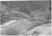 Right half of Dolores River valley panoramic picture paired with RD141-014.  This part shows upstream side view of RGS Bridge 78-A.<br /> RGS  Priest Gulch, CO  1947
