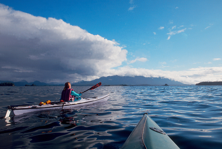 Woman kayaking Clayoquot Sound; west coast of Vancouver Island; British Columbia; Canada;