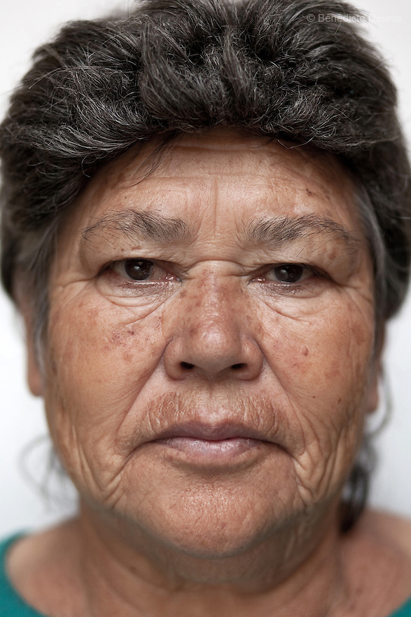 Portrait of Raquel, a resident of Casa Xochiquetzal, at the shelter in Mexico City on Septemer 14, 2010. Casa Xochiquetzal is a shelter for elderly sex workers in Mexico City. It gives the women refuge, food, health services, a space to learn about their human rights and courses to help them rediscover their self-confidence and deal with traumatic aspects of their lives. Casa Xochiquetzal provides a space to age with dignity for a group of vulnerable women who are often invisible to society at large. It is the only such shelter existing in Latin America. Photo by Bénédicte Desrus