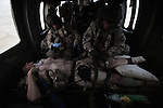 "A flight medic and medical officer work to treated and stabilize a Canadian soldier who has just lost his left foot to an IED strike in western Kandahar province. Scenes from the medical evacuations of wounded Americans, Canadians, and Afghan civilians and soldiers being flown by Charlie Co. 6th Battalion 101st Aviation Regiment of the 101st Airborne Division. Charlie Co. - which flies under the call-sign ""Shadow Dustoff"" - flies into rush the wounded to medical care out of bases scattered across Oruzgan, Kandahar, and Helmand Provinces in the Afghan south. These images were taken of missions flown out of Kandahar Airfield in Kandahar Province and Camp Dwyer in Helmand Province."