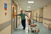 A porter at Glasgow Royal Infirmary, where all hospital ancillary services are provided by directly employed staff.  A PFI contract with Sodexho ended in 2006 following successful industrial action over pay and conditions.  The success of the in-house services influenced the Scottish Parliament's 2008 decision to bring all hospital cleaning in Scotland in-house.