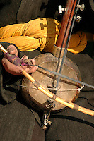 A Uyghur man plays a Dolan Rawap (Rebab). Musical instruments of Uyghur people have a long history. They are used to accompany the Dolan dance, an ancient Uyghur folk dance popular in China's Xinjiang Uygur Autonomous Region.