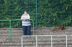 The groundsman's dog watching on from the terracing