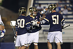 DURHAM, NC - APRIL 28: Notre Dame's Mikey Wynne (center) is mobbed by Ryder Garnsey (50) and Brendan Collins (51) after scoring a goal. The Duke University Blue Devils played the University of Notre Dame Fighting Irish on April 28, 2017, at Koskinen Stadium in Durham, NC in a 2017 ACC Men's Lacrosse Tournament Semifinal match. Notre Dame won the game 7-6.