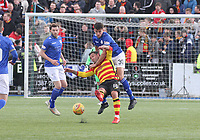Barry Maguire gets the better of Scott McDonald in the SPFL Ladbrokes Championship football match between Queen of the South and Partick Thistle at Palmerston Park, Dumfries on  4.5.19.