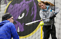 NWA Media/DAVID GOTTSCHALK - 12/31/14 - Emily Lyles, right, and Lily Hocklander (cq), left, both freshman members of the Fayetteville High School Softball team, practice t drills inside The Kennel at Fayetteville High School Softball Field in Fayetteville Wednesday December 31, 2014. The season opener for the Lady Bulldogs is February 23, 2015 against Van Buren High School in Fayetteville.