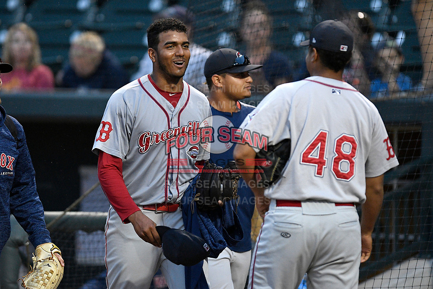 Pitcher Denyi Reyes (41) of the Greenville Drive, left, is congratulated after using just 92 pitches to post a nine-inning complete-game shutout against the Columbia Fireflies on Sunday, May 27, 2018, at Spirit Communications Park in Columbia, South Carolina. Greenville won, 3-0. It was the first complete-game shutout in the South Atlantic League this season.(Tom Priddy/Four Seam Images)