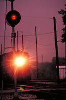 Train's headlight shown approaching signal light. Houston Texas USA Hardy Street Engine Facility.