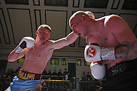 Sean Phillips (blue shorts) defeats Daryl Sharp during a Boxing Show at York Hall on 2nd February 2019