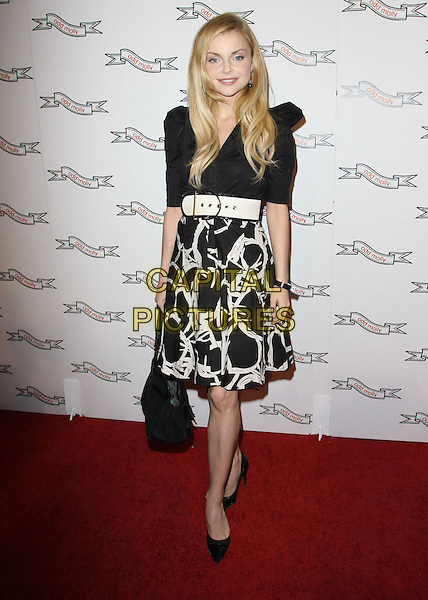 IZABELLA MIKO.Odd Molly Flagship Store Opening held At Odd Molly Boutique, Beverly Hills, California, USA, 19th March 2010..full length black shirt and white print dress skirt waist belt bag shoes puff sleeve shoulder puffy shoulders .CAP/ADM/KB.©Kevan Brooks/AdMedia/Capital Pictures.