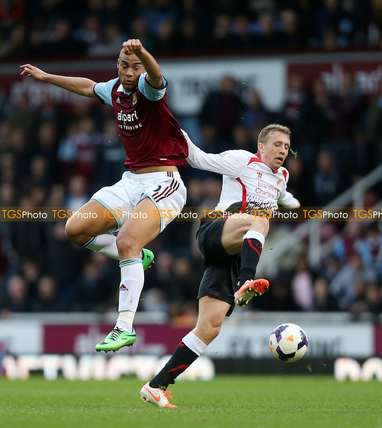 Winston Reid of West Ham and Lucas of Liverpool - West Ham United vs Liverpool, Barclays Premier League at Upton Park, West Ham, London - 06/04/14 - MANDATORY CREDIT: Rob Newell/TGSPHOTO - Self billing applies where appropriate - 0845 094 6026 - contact@tgsphoto.co.uk - NO UNPAID USE