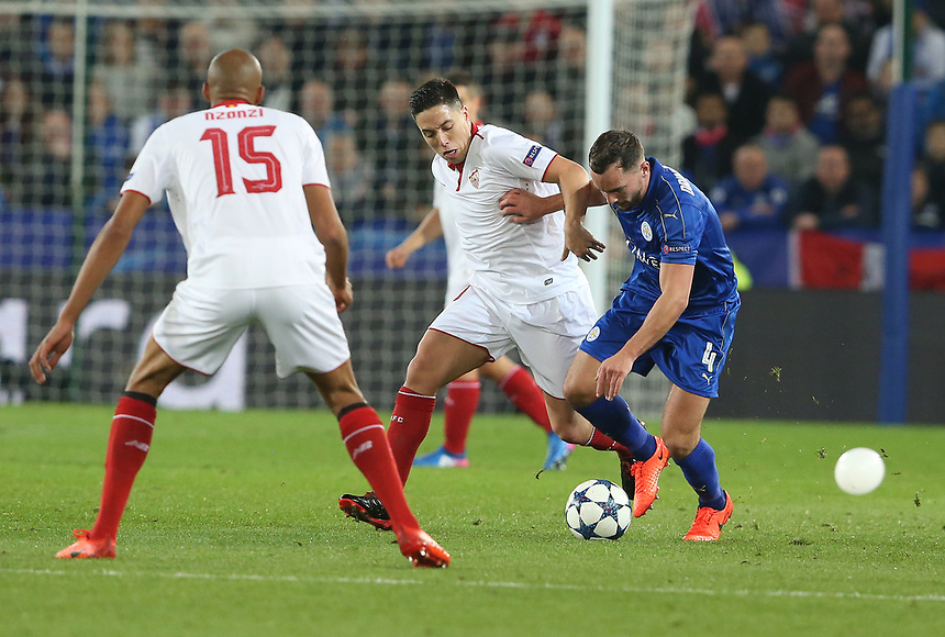 Leicester City's Daniel Drinkwater holds off the challenge fromSevilla's Samir Nasri<br /> <br /> Photographer Stephen White/CameraSport<br /> <br /> UEFA Champions League Round of 16 Second Leg - Leicester City v Sevilla - Tuesday 14th March 2017 - King Power Stadium - Leicester <br />  <br /> World Copyright &copy; 2017 CameraSport. All rights reserved. 43 Linden Ave. Countesthorpe. Leicester. England. LE8 5PG - Tel: +44 (0) 116 277 4147 - admin@camerasport.com - www.camerasport.com