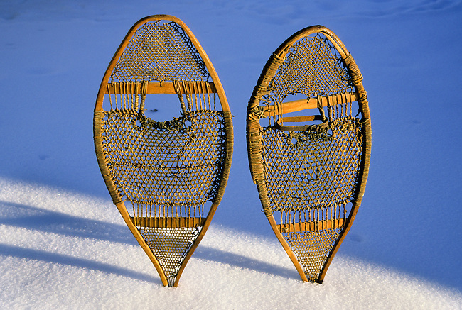 Snow shoes were typically used by the Subarctic and Arctic peoples for walking on deep snow. Made from a racket-shaped wooden frame, webbing and thongs to attach the foot..Property released