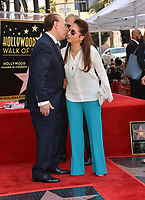 LOS ANGELES, CA. October 10, 2019: Tommy Mottola & Gloria Estefan at the Hollywood Walk of Fame Star Ceremony honoring Tommy Mottola.<br /> Pictures: Paul Smith/Featureflash