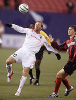 Real Salt Lake's Clint Mathis is marked by Michael Bradley of the MetroStars'. The weather was the story with 50 mph winds, rain, and a brief power outage as the MetroStars played Real Salt Lake to a scoreless tie during opening day action of season 10 of the MLS at Giant's Stadium, East Rutherford, on Saturday April 2, 2005.