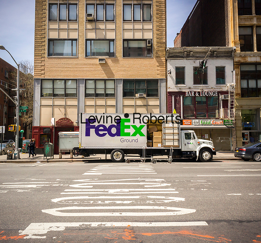 A FedEx truck parked in New York on Tuesday, April 19, 2016. (© Richard B. Levine)