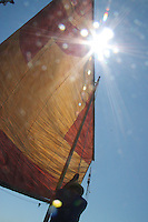 Sailing in an almost windless regata in  the Venetian lagoon, vela al terzo in a traditional wooden boat, the caorlina.