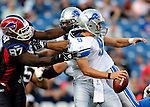 3 September 2009:  Detroit Lions' rookie quarterback Matthew Stafford is sacked for a 7 yard loss by Buffalo Bills' defensive tackle John McCargo during a pre-season game against the Buffalo Bills at Ralph Wilson Stadium in Orchard Park, New York. The Lions defeated the Bills 17-6...Mandatory Photo Credit: Ed Wolfstein Photo