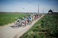 Large regrouping of the peloton after sector 25: Qui&eacute;vy to Saint-Python (3.7km). Iljo Keisse (BEL/Etixx-QuickStep) leading them.<br /> <br /> 113th Paris-Roubaix 2015