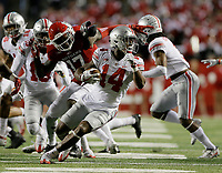 Ohio State Buckeyes wide receiver K.J. Hill (14) spins around Rutgers Scarlet Knights defensive back K.J. Gray (17) on a punt return during the second quarter of the NCAA football game at Highpoint Solutions Stadium in Piscataway, New Jersey on Sept. 30, 2017. [Adam Cairns / Dispatch]