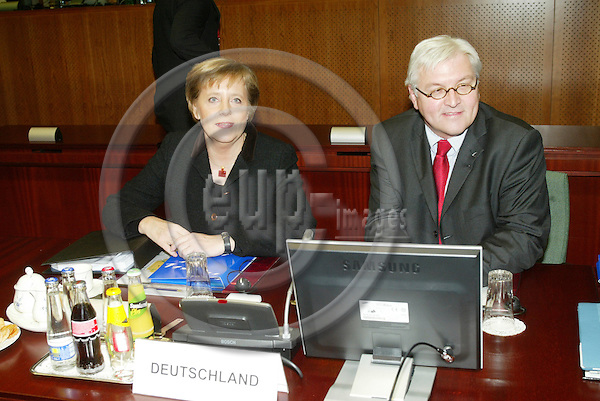 BRUSSELS - BELGIUM - 15 DECEMBER 2005 -- EU SUMMIT -- Frank-Walter STEINMEIER, Minister for Foreign Affairs of Germany and Angela MERKEL Federal Chancellor of Germany attending their first EU Summit.  PHOTO: ERIK LUNTANG / EUP-IMAGES